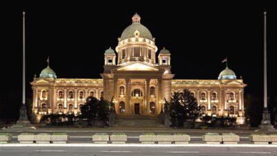[Photo: Serbian Parliament Building in Belgrade at Night]
